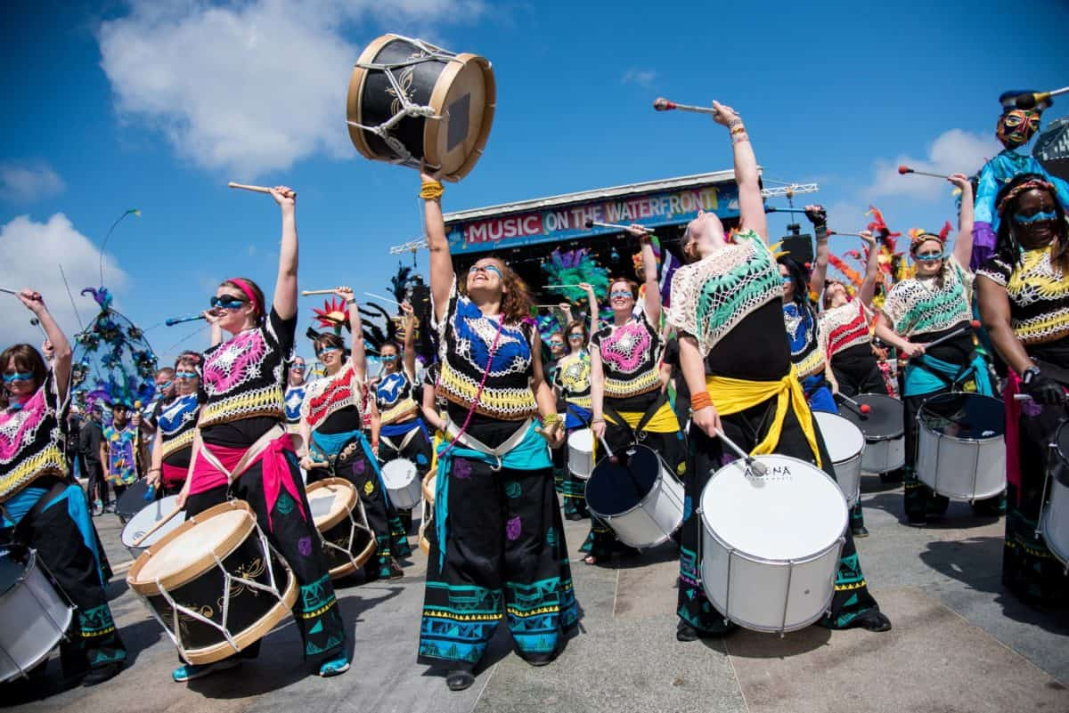 Female drummers in costume at the Music on the Waterfront Festival